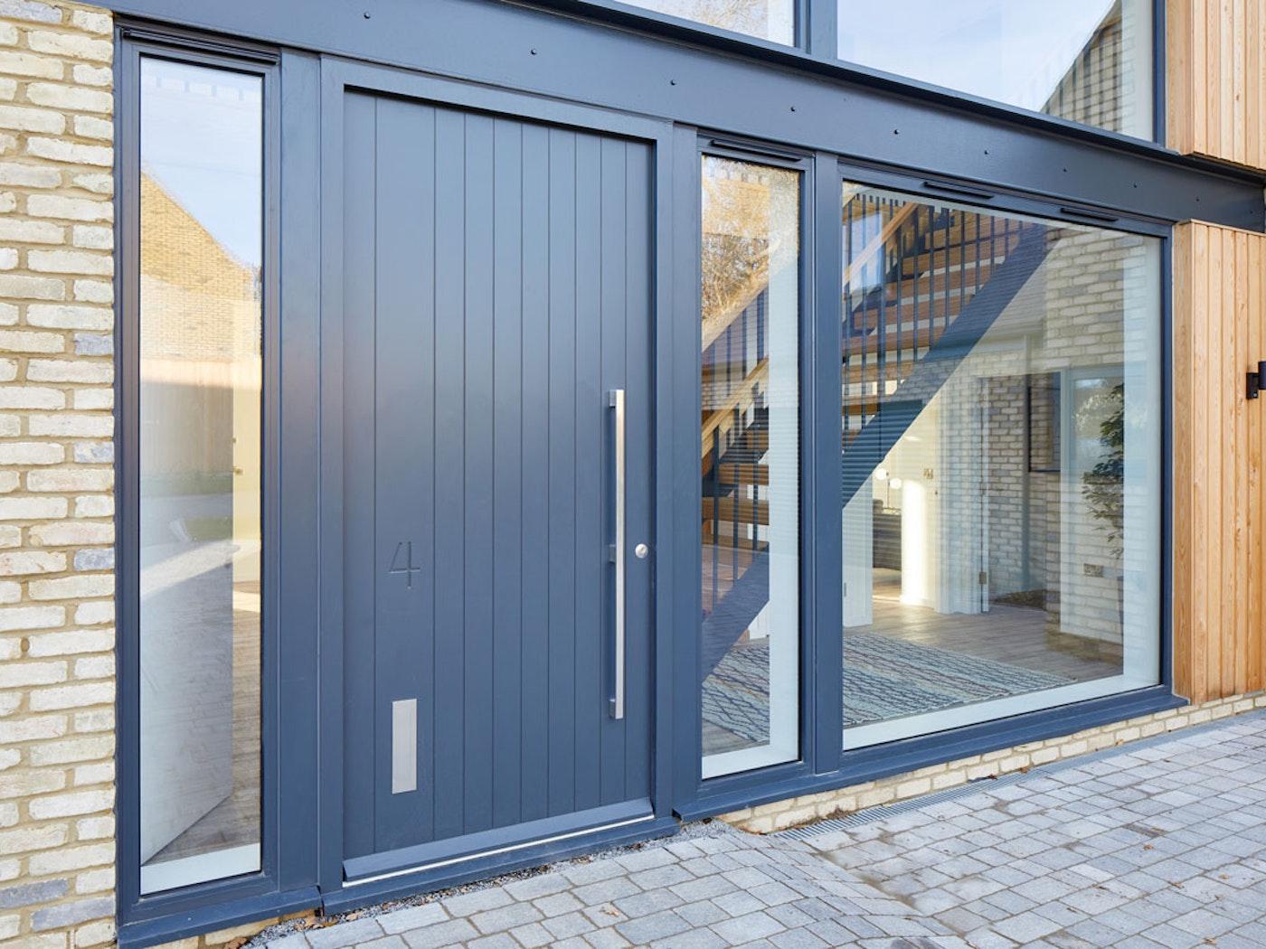 Numero front door | Grey painted | Vertical grooves | Urban Front