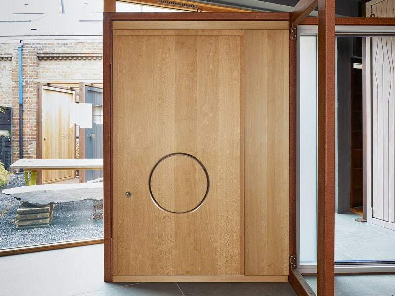 """Simple, striking design - the """"Ring"""" in European oak shows an eye-catching, concealed circular handle"""