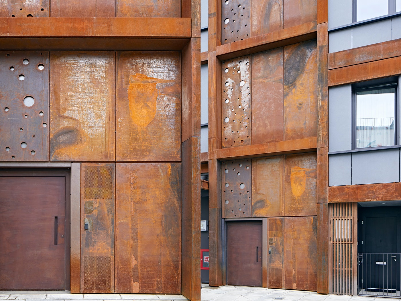 This large steel door fits perfectly with the mixed industrial aesthetic of the building