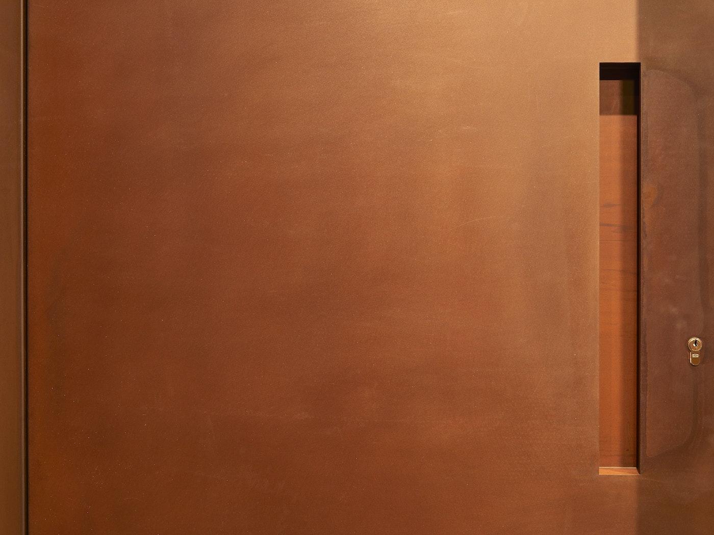 """""""Raw"""" corten steel door (rust) with concealed handle"""