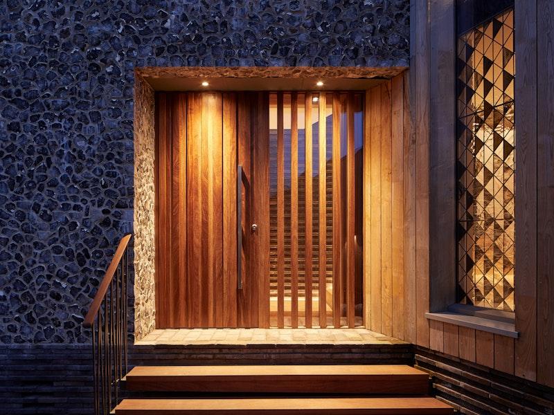 Bespoke Iroko hardwood door designed by the architects