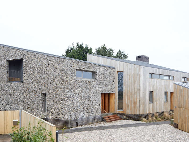 The mix of cladding and flint stone walls is the perfect compliment to its Nofolk location