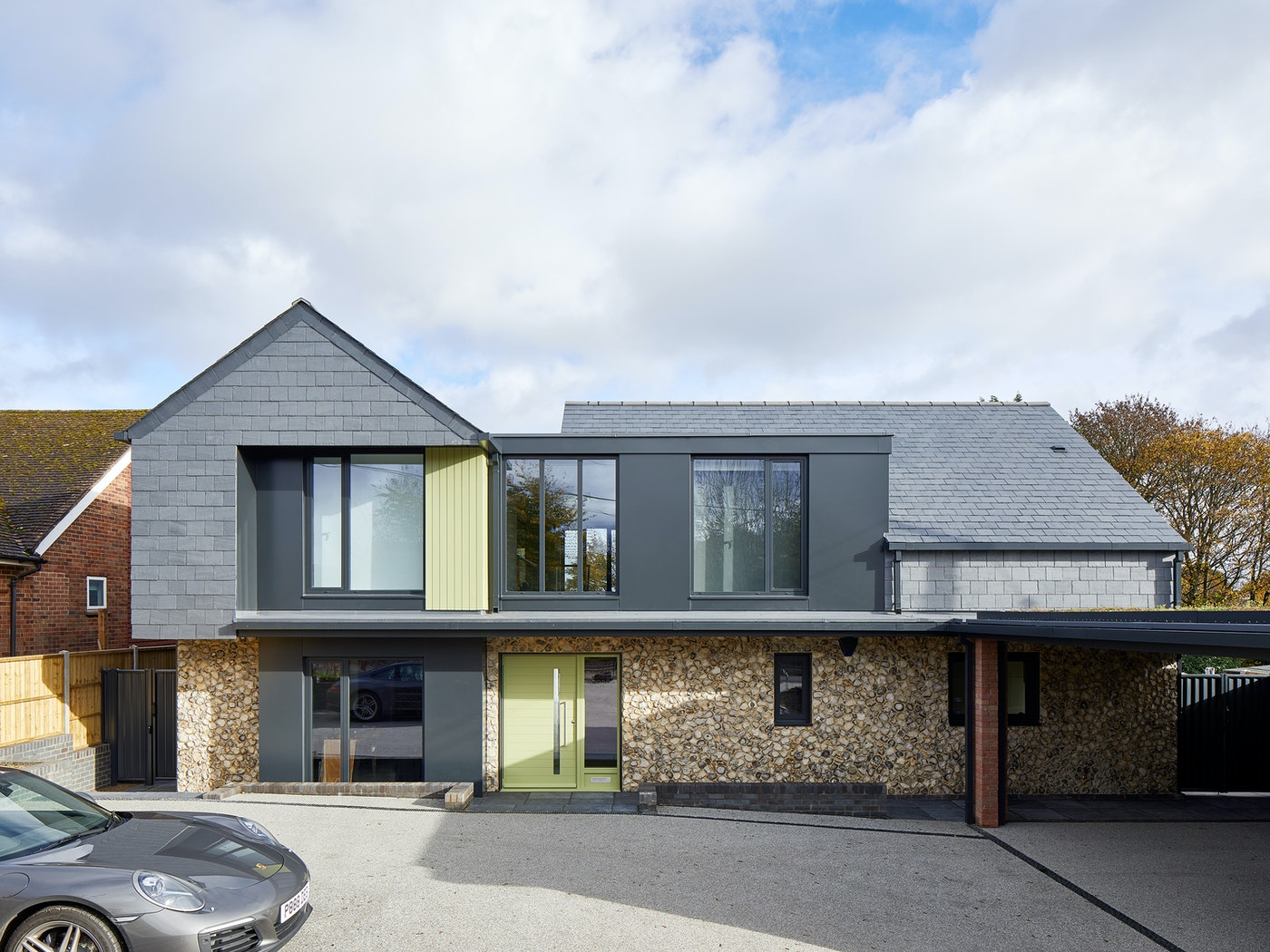 Our Terano green door draws the eye on this mixed material frontage while the artfully placed matching cladding on the second floor literally takes the whole thing to a new level