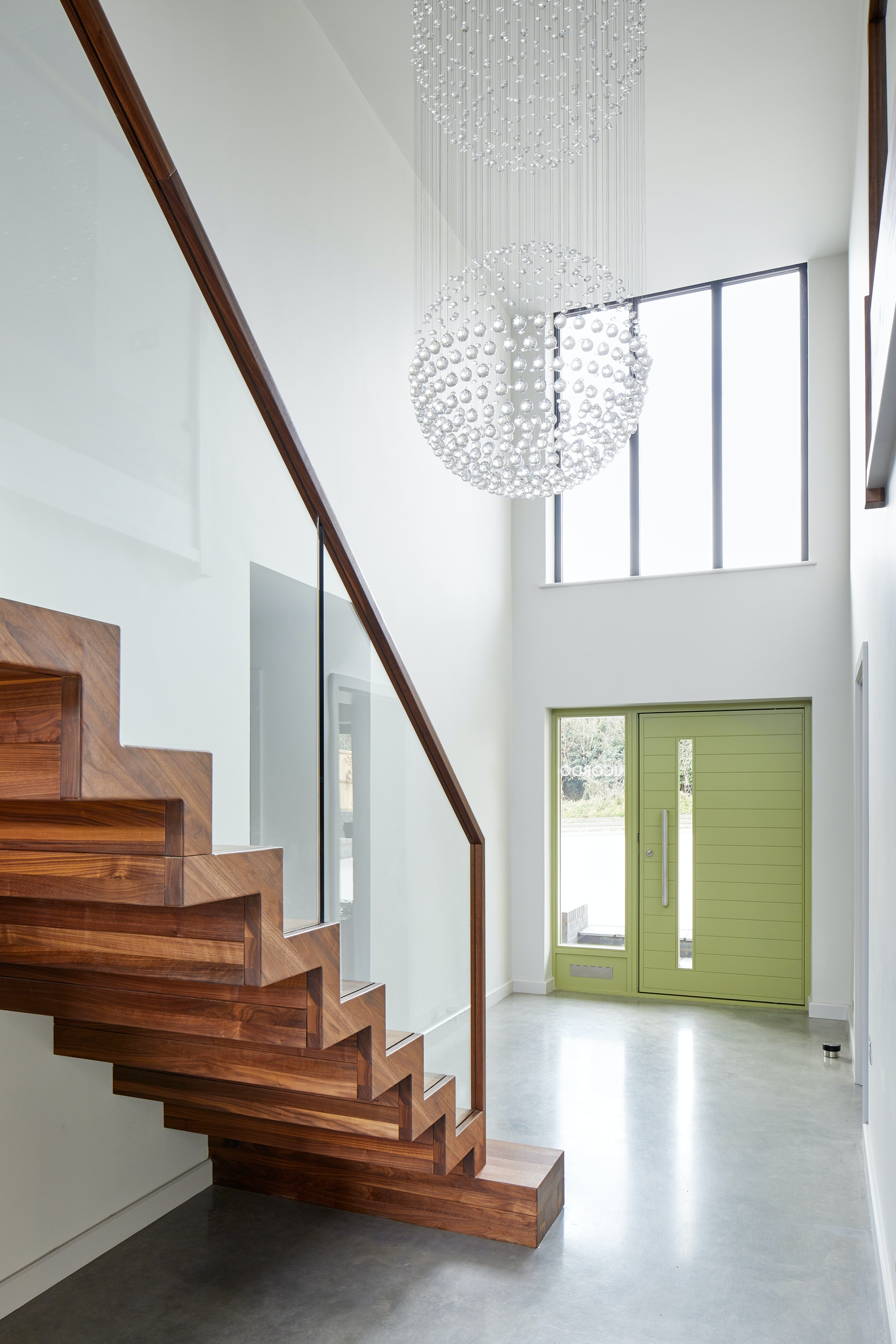 Green terano door with sidelite and panel