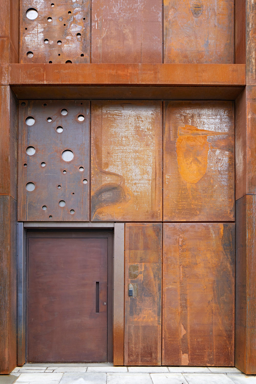 raw steel door in a corten rust finish